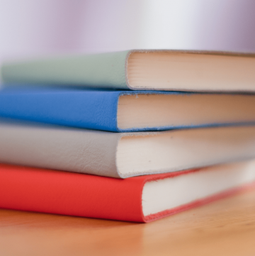 image of a stack of multi-colored books - featured image for Keto Diet Resources page