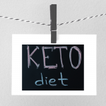 "Image of a sign pinned to a clothes line. Text reads ""Keto Diet"""