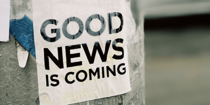 "Image of a sign on a tree that reads ""good news is coming"""