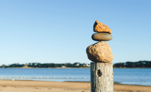 image of rocks on a pole at the beach